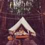 4.5m diameter Bell Tent styled beautifully for a dinner in the forest