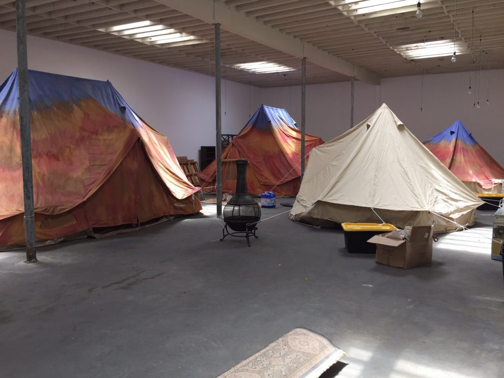 Bell Tents being painted by scenic artists in LA